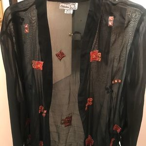 Sheer black jacket with embroidery.